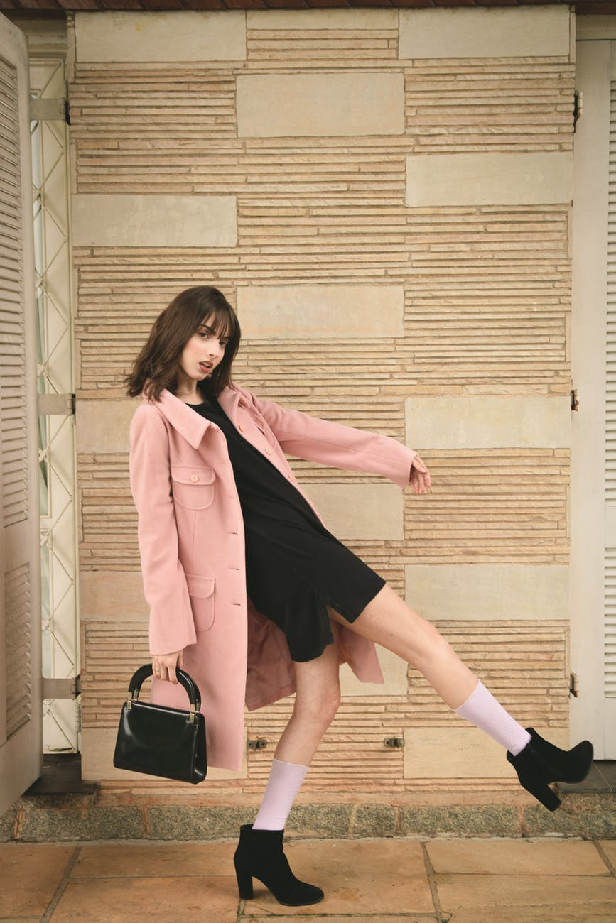 woman wearing pink overcoat and black inner top